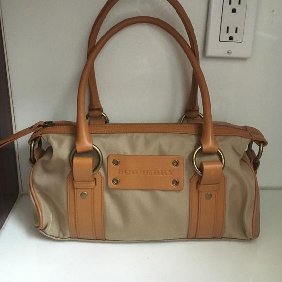 334091b82d5d Burberry Handbags - Vintage Burberry Nylon and Leather Handbag