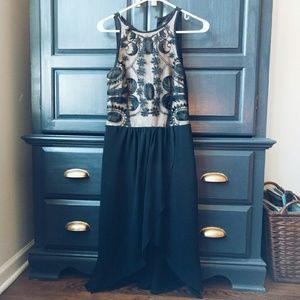 High low black and tan dress with lace detail