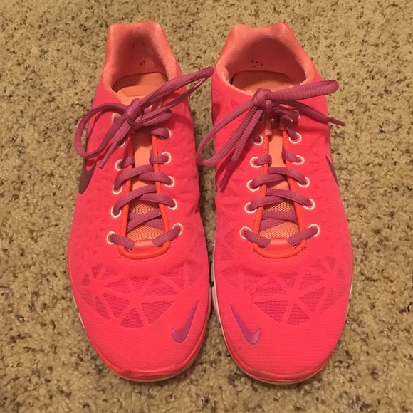 new styles 55053 89e3d Neon pink, orange, and purple Nike free runs 5.0