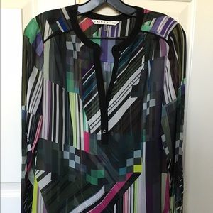 Trina Turk multi-colored sheer blouse.