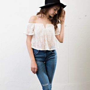 April Spirit Tops - White lace overlay top. Price firm.