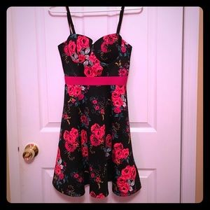 Floral skater dress with corset top and caged back