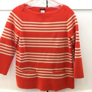 J. Crew orange and cream striped top.