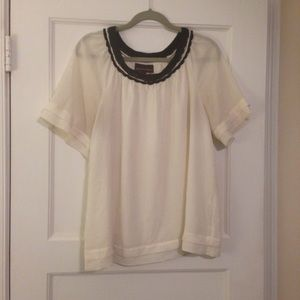 Dana Buchman Tops - Cream short sleeve top w/black scalloped neckline.