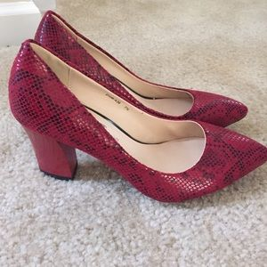 Red classic pumps