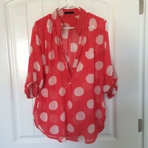 Red and white polkadot blouse