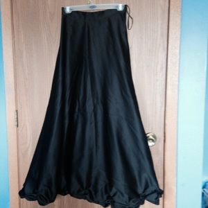 Black satin look maxi skirt.