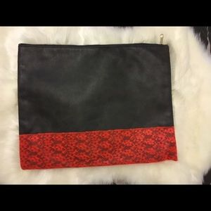 Faux leather and lace clutch