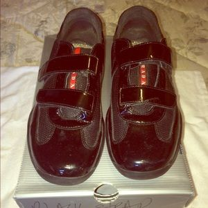 red and black prada shoes