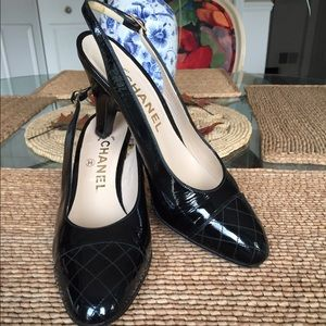 CHANEL...Black patent leather pumps