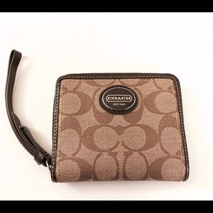 Authentic Coach wallet in sturdy coated canvas