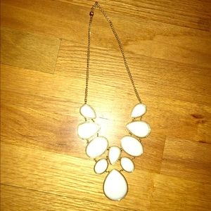 White stones. Gold chain necklace