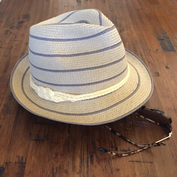 A soft felt men's hat with a deeply indented crown and a narrow brim often upturned at the back. Tricorne A soft hat with a low crown and broad brim, pinned up on either side of the head and at the back, producing a triangular shape.
