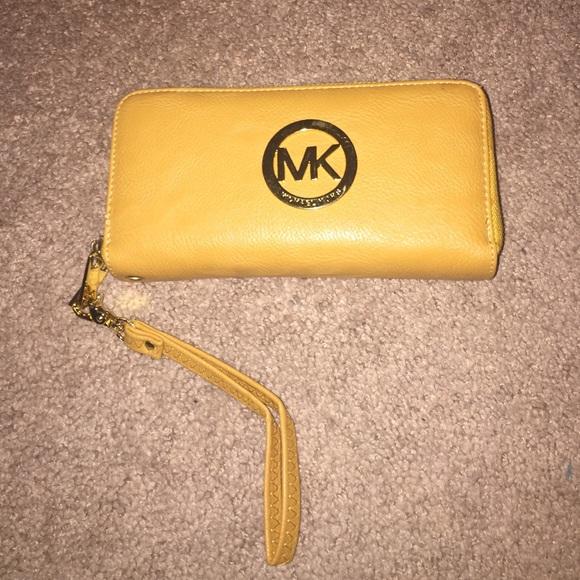 2ce3bde0bed971 Michael Kors Mustard Double Zip Wallet. M_572308316d64bcb6e5000ed0
