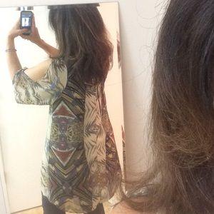 Silky dress straight from shoulder to hemline