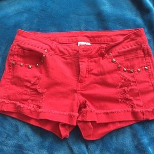 Red studded shorts