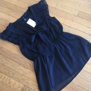 H&M black top with lace and bow detail. Size 8