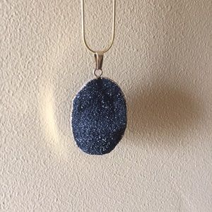 Gold necklace with crystal rock pendant