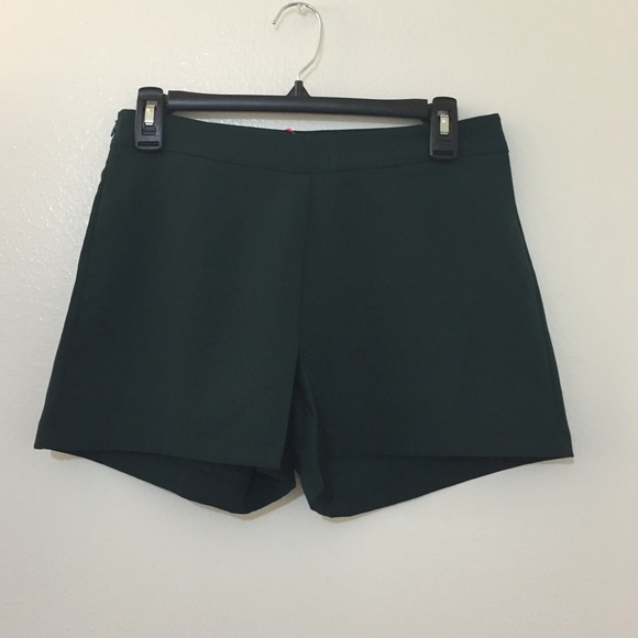 Make a bright statement this festival season with these neon green high-waisted shorts. Back zipper closure. 92% polyester; 8% spandex Wash cold; dry low Imported Listed in junior sizes Make a bright statement this festival season with these neon green high-waisted shorts.