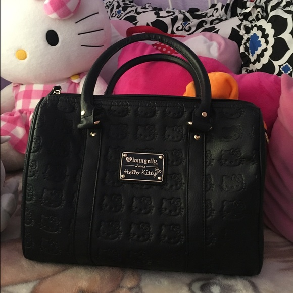 c4f10420b Loungefly Handbags - Hello Kitty Black Embossed Faux Leather Duffle Bag