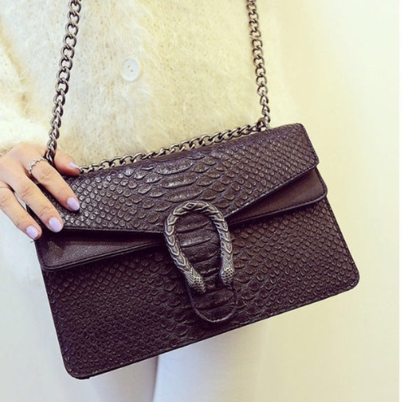 b3906d60d398 Black large cross-body Dionysus python bag