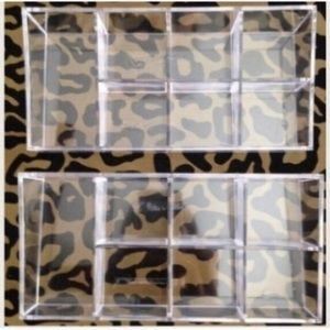 Two clear acrylic divided makeup storage trays