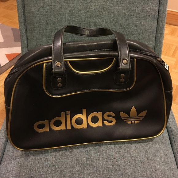 gold and black adidas bag