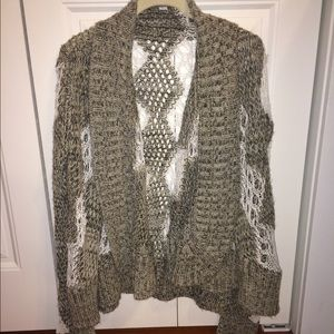 Poof cozy, distressed sweater