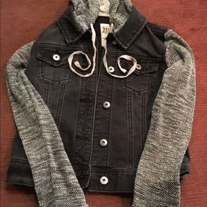 Blue denim crop jacket with sweater sleeves.