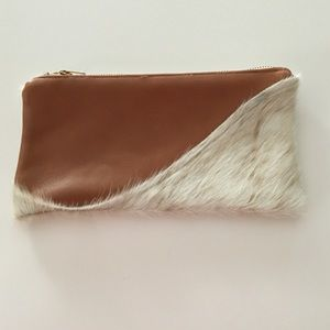 Handbags - Faux leather and faux calf hair clutch.
