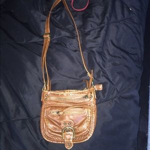 Tan cross body purse