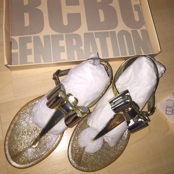 7bcf2c815b90 BCBGeneration Shoes - BCBG GOLD JELLY BOW SANDALS! NEW. US SIZE 6.