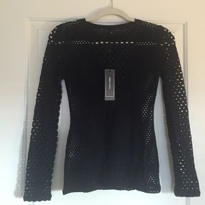 BCBG MAXAZRIA Chic long sleeved black caged top!