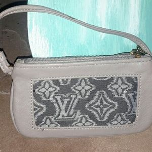 Gray leather wristlet with pattern front