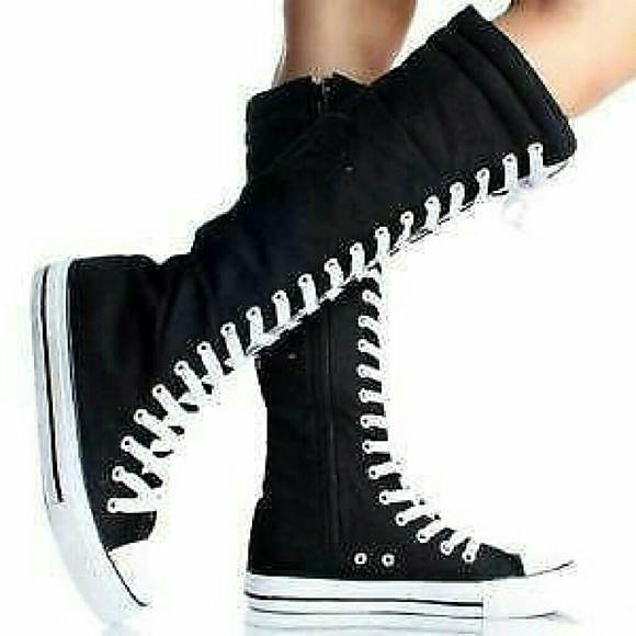 CONVERSE ALL STAR zip and lace up knee high shoe boots. Boots are approximately 15 inches tall. Boots are used but show very minimal signs of wear. Size 6 womens/4 mens.