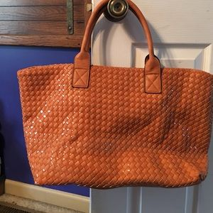 Leather woven bag.