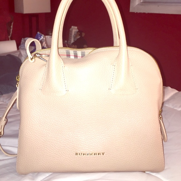 51d05b9dee04 Brand new cream colored Burberry bag! Never used