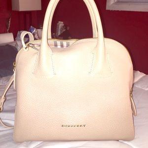 ab93c6bdb540 Burberry Bags - Brand new cream colored Burberry bag! Never used