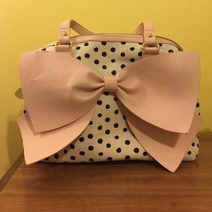 White purse w/ black polka dots & pink bow