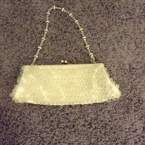 White beaded purse with short handle