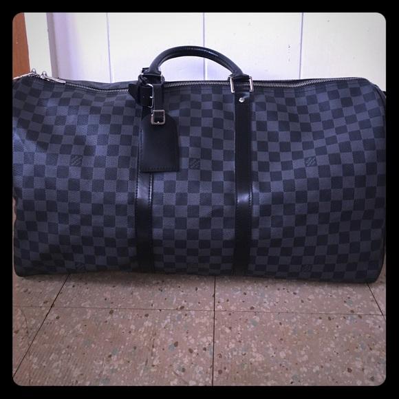 2946d5095c6 Louis Vuitton Handbags - LV black and grey duffle bag. Excellent item