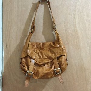 Brown leather saddle shoulder bag