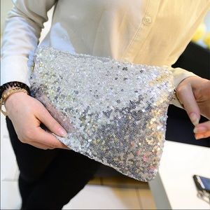 Handbags - SALE! NEW! Oversized silver sequin clutch purse
