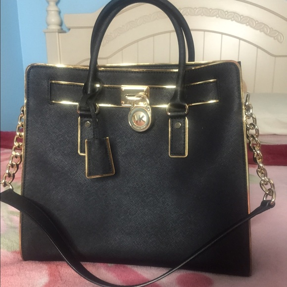 ... black bag with MK Gold Lock. M 5733dc10620ff79f99007e31 04d9580df03b9