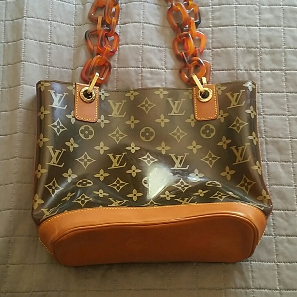 a8ce231ed3a Louis Vuitton Handbags - Louis Vuitton Clear Ambre Monogram Tote Bag