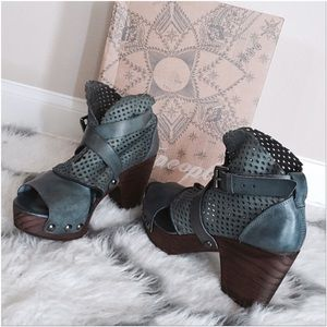 buckled perforated clogs