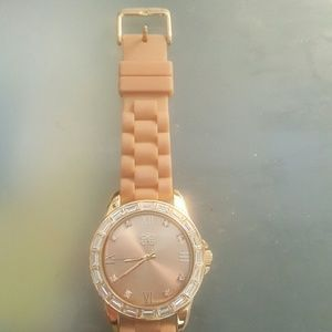 Jewelry - Gold watch with tan plastic straps.