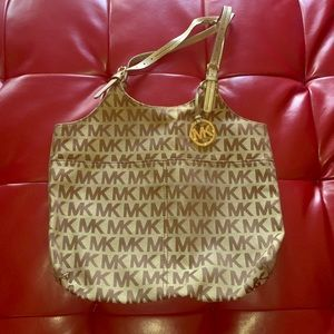 Gently used MK tote - pictures show defects