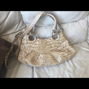 Beautiful neutral beige snakeskin bag.
