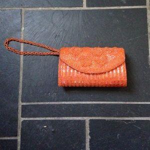 Handbags - Orange beaded clutch